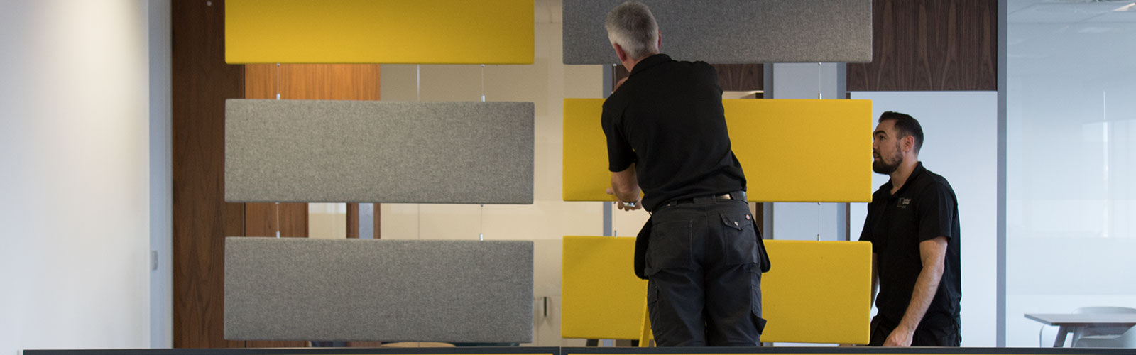 Penketh Group office fit out experts installing yellow and grey furniture